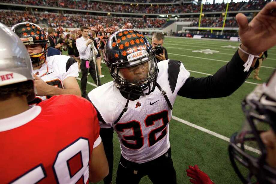 Aledo running back Jonathan Gray (32) congratulates Manvel players after the 4A Div. 2 state championship high school football game at Cowboys Stadium on Saturday, Dec. 17, 2011, in Arlington.  Aledo won the game 49-28. Photo: Smiley N. Pool, Houston Chronicle / © 2011  Houston Chronicle