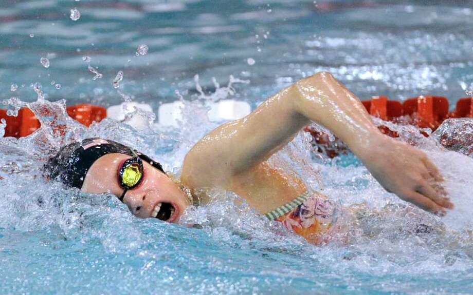 Alex Walsh, 10 of the Greenwich Dolphins, wins the 50 yard freestyle event for her divison during the YWCA of Greenwich 11th annual Greenwich Town Swimming Championships at Greenwich High School, Saturday, Dec. 17, 2011. Photo: Bob Luckey / Greenwich Time