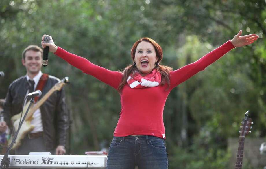 "Leah White and The Magic Mirrors sing ""Snow Angel"" as they perform a holiday concert as part of the Snow Day at the Houston Zoo on Saturday, December 17, 2011. The Houston Zoo and Sunny 99.1 brought in 15,000 pounds of snow  for the event. Photo: Alan Warren, Houston Chronicle / ©2011 Houston Chronicle"