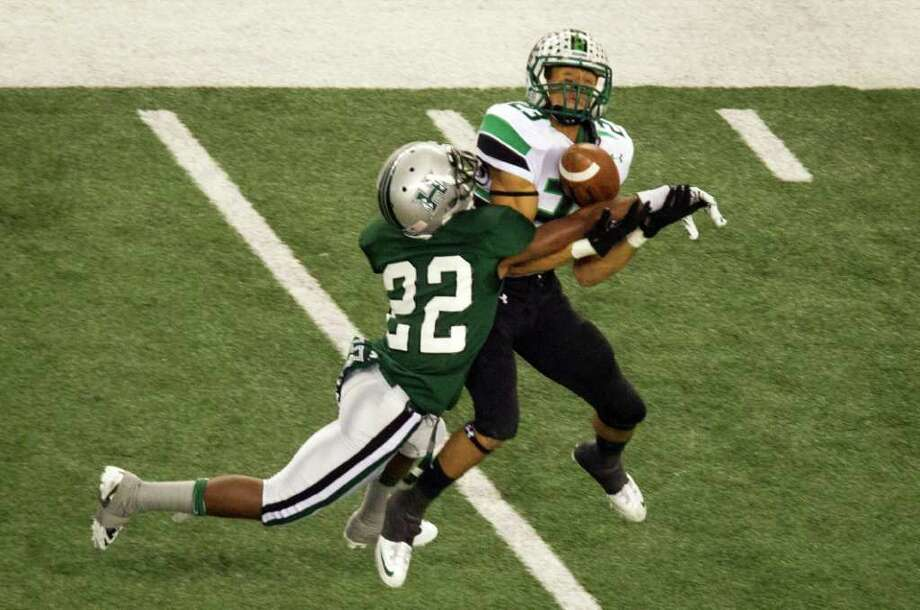 Hightower defensive back Casey Edgley (22) breaks up a pass intended for Southlake Carroll wide receiver Sabian Holmes (23) during the first quarter of the 5A Div. 1 state championship high school football game at Cowboys Stadium on Saturday, Dec. 17, 2011, in Arlington. Photo: Smiley N. Pool, Houston Chronicle / © 2011  Houston Chronicle