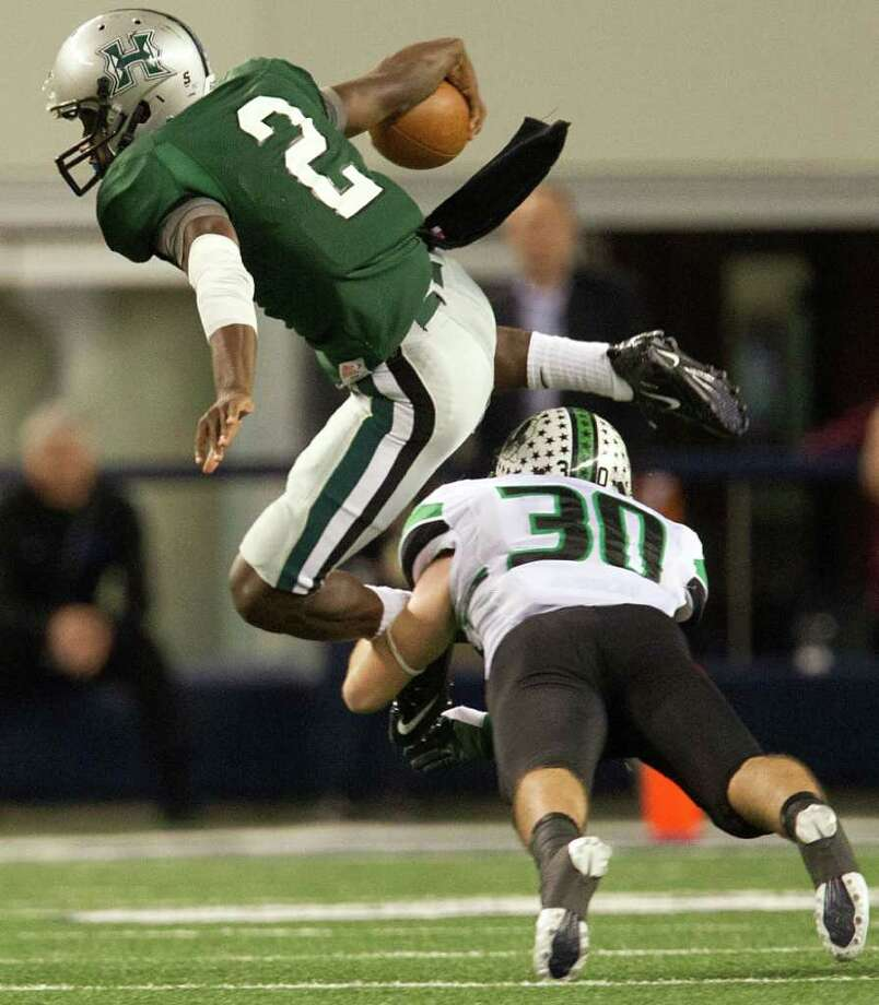 Hightower quarterback Bralon Addison (2) tries to leap over Southlake Carroll defensive back Matt Swoyer (30) during the second quarter of the 5A Div. 1 state championship high school football game at Cowboys Stadium on Saturday, Dec. 17, 2011, in Arlington. Photo: Smiley N. Pool, Houston Chronicle / © 2011  Houston Chronicle