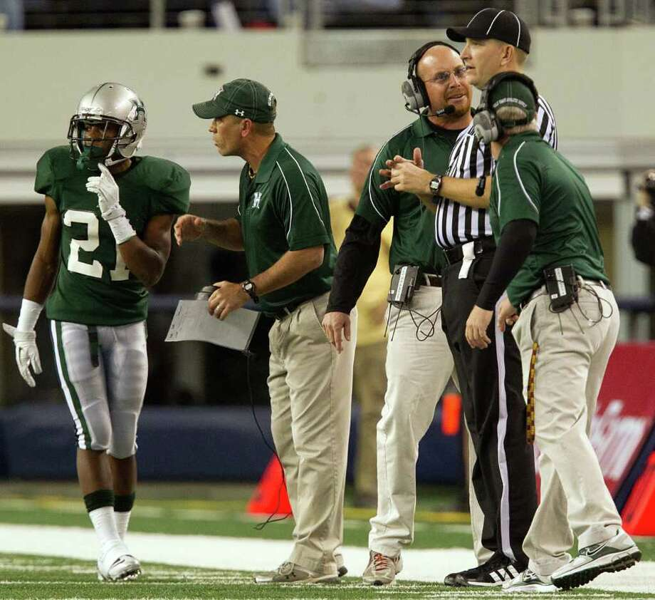 Hightower head coach Barry Abercrombie questions an official during the second quarter of the 5A Div. 1 state championship high school football game against Southlake Carroll at Cowboys Stadium on Saturday, Dec. 17, 2011, in Arlington. Photo: Smiley N. Pool, Houston Chronicle / © 2011  Houston Chronicle