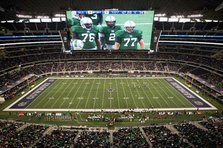 Hightower quarterback Bralon Addison (2) is seen on the overhead video screen as he lines up his team during the first quarter of the 5A Div. 1 state championship high school football game against Southlake Carroll at Cowboys Stadium on Saturday, Dec. 17, 2011, in Arlington. Photo: Smiley N. Pool, Houston Chronicle / © 2011  Houston Chronicle