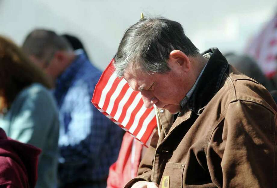 A supporter bows his head in prayer at a rally at the Henderson County Courthouse in Athens on Saturday. He and others rallied in support of a Nativity scene targeted by the Freedom From Religion Foundation. Photo: Sarah A. Miller, Associated Press / 2011 Sarah A. Miller / Tyler Morning Telegraph