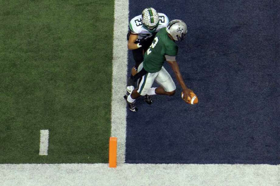 Hightower quarterback Bralon Addison (2) crosses the goal line past Southlake Carroll defensive back Sabian Holmes (23) during the second quarter of the 5A Div. 1 state championship high school football game at Cowboys Stadium on Saturday, Dec. 17, 2011, in Arlington. Photo: Smiley N. Pool, Houston Chronicle / © 2011  Houston Chronicle