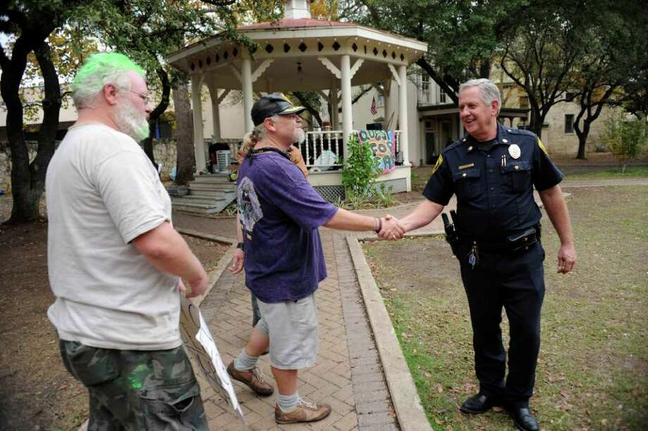 Chief Steven Baum, right, of the San Antonio Park Police Division, greets Occupy San Antonio members on Wednesday, Dec. 14, 2011. Baum asked the group members to be better about cleaning up after themselves. Dec. 14, 2011. BILLY CALZADA / gcalzada@express-news.net  taste Photo: BILLY CALZADA, SAN ANTONIO EXPRESS-NEWS / gcalzada@express-news.net