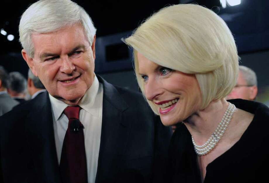 Republican presidential candidate Newt Gingrich,  and his wife Callista Gingrich speak after the debate at the Benjamin Johnson Arena, Saturday, Nov. 12, 2011 in Spartanburg, S.C. Republican presidential hopefuls sharply criticized President Barack Obama's efforts to thwart Iran's nuclear ambitions Saturday night as too weak but disagreed in campaign debate whether the United States would be justified in a pre-emptive military strike. Photo: AP