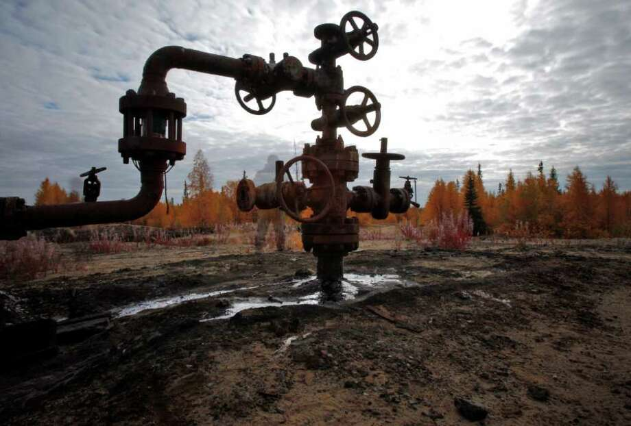 This Saturday, Sept. 10, 2011 photo shows an oil spill near the town of Usinsk, 1500 kilometers (930 miles) northeast of Moscow. Komi is one of Russia's largest and oldest oil provinces but ruptures in aging pipelines and leaks from decommissioned oil wells make oil spills in the region routine. (AP Photo/Dmitry Lovetsky) PHOTO MADE WITH LONG EXPOSURE Photo: Dmitry Lovetsky / AP