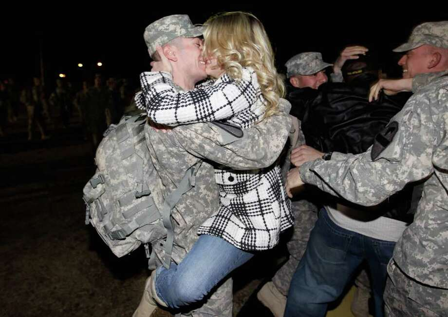 U.S. Army Staff Sergeant Chad Johnson from the 2-82 Field Artillery, 3rd Brigade, 1st Cavalry Division, is greeted as he arrives at the home base of Fort Hood, Texas after being part of one of the last American combat units to exit from Iraq on December 16, 2011 in Fort Hood, Texas. Photo: Joe Raedle, Getty / 2011 Getty Images