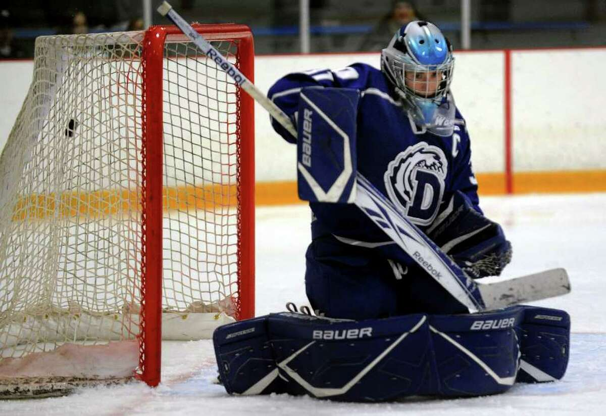 Darien goalie Max Rothston fails to stop a West Haven shot during boys hockey action in West Haven, Conn. on Saturday December 17, 2011.