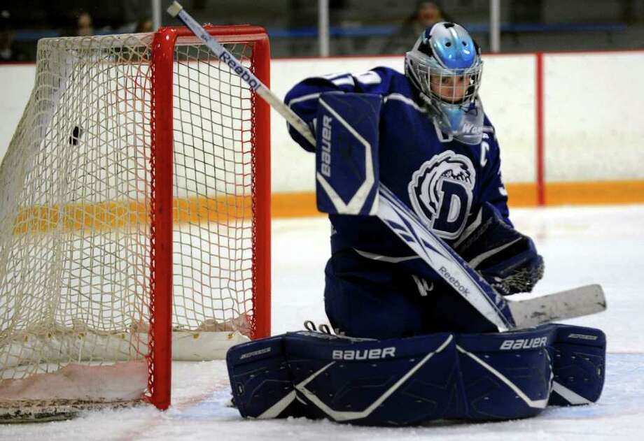 Darien goalie Max Rothston fails to stop a West Haven shot during boys hockey action in West Haven, Conn. on Saturday December 17, 2011. Photo: Christian Abraham / Connecticut Post
