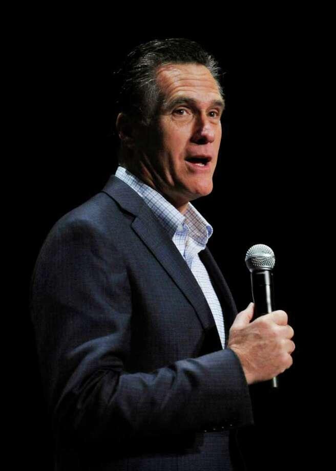 Republican presidential candidate and former Massachusetts Gov. Mitt Romney speaks during a town hall meeting at Memminger Auditorium, Saturday, Dec. 17, 2011, in Charleston, S.C.  (AP Photo/Rainier Ehrhardt) Photo: Rainier Ehrhardt / FR155191 AP