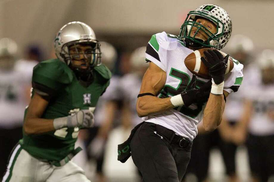 Southlake Carroll wide receiver Sabian Holmes (23) hauls in a 59-yard touchdown pass against Hightower during the second half of the 5A Div. 1 state championship high school football game at Cowboys Stadium on Saturday, Dec. 17, 2011, in Arlington.  Southlake Carroll won the game 36-29. Photo: Smiley N. Pool, Houston Chronicle / © 2011  Houston Chronicle