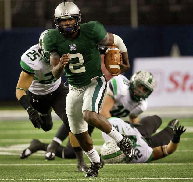Hightower quarterback Bralon Addison (2) leaves three Southlake Carroll defenders behind as he races