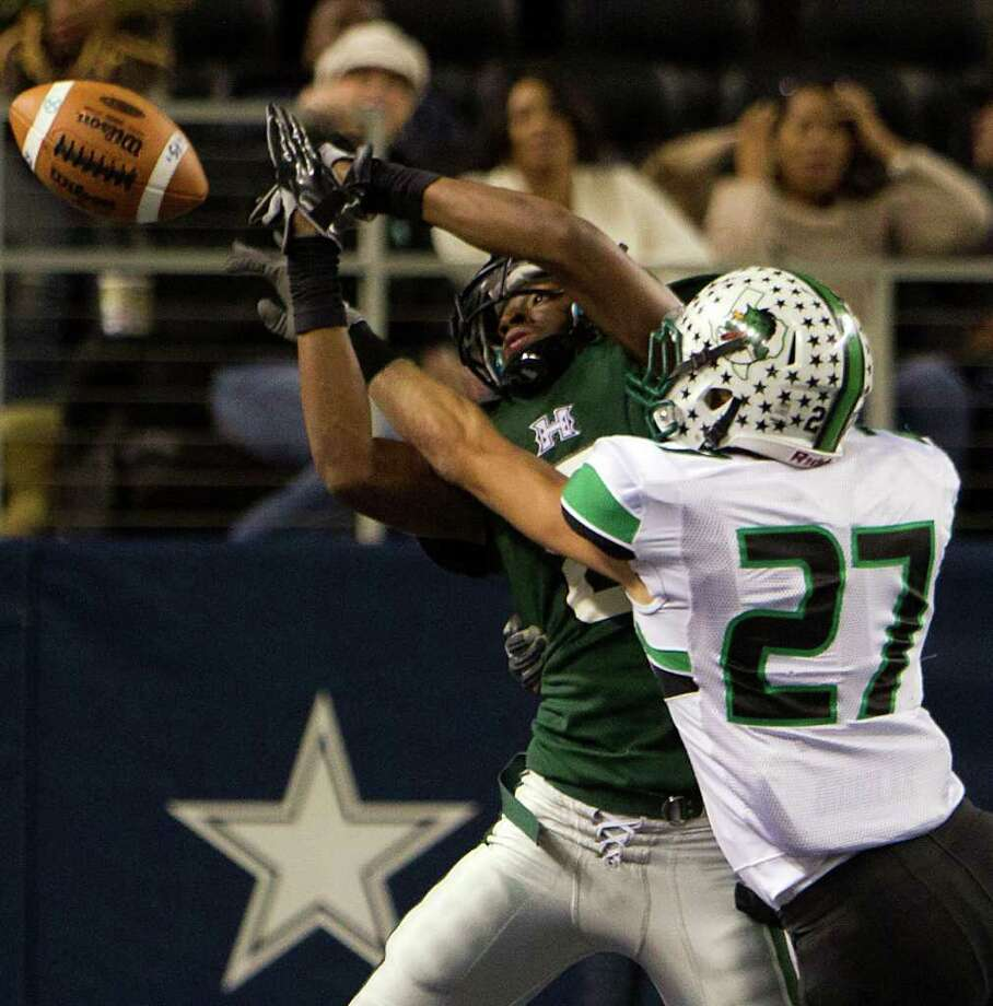 Southlake Carroll defensive back Nick Melocki (27) knocks a pass away from Hightower wide receiver Donald Weathersby (8) thwarting a two-point conversion attempt during the second half of the 5A Div. 1 state championship high school football game at Cowboys Stadium on Saturday, Dec. 17, 2011, in Arlington.  Southlake Carroll won the game 36-29. Photo: Smiley N. Pool, Houston Chronicle / © 2011  Houston Chronicle