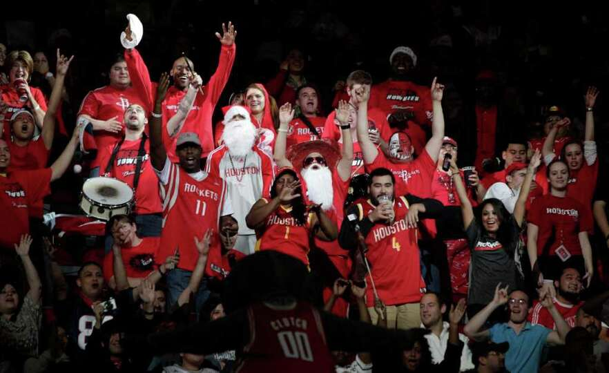 Houston Rockets cheer during the first half of a pre-season NBA basketball game against the San Anto
