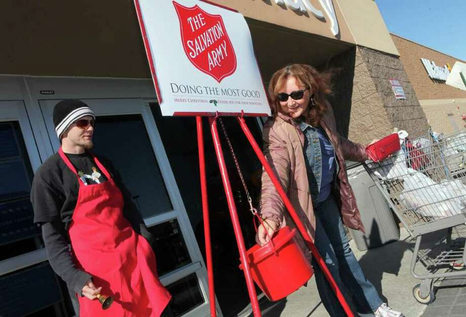 ASSOCIATED PRESS FILE ICONIC: Scenes like this one in Jacksonville, N.C., epitomize the Salvation Army's red-kettle drive, during which volunteers across the nation broke its 36-hour record for bell-ringing. Photo: JOHN ALTHOUSE / THE DAILY NEWS