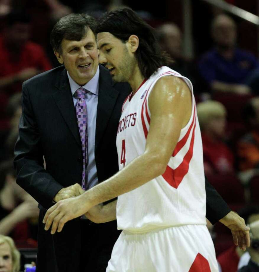 Houston Rockets head coach Kevin McHale argues a call greets  Rockets power forward Luis Scola (4) as he comes off the court during the first half of a pre-season NBA basketball game against the San Antonio Spurs at Toyota Center Saturday, Dec. 17, 2011, in Houston. Photo: Brett Coomer, Chronicle / © 2011 Houston Chronicle