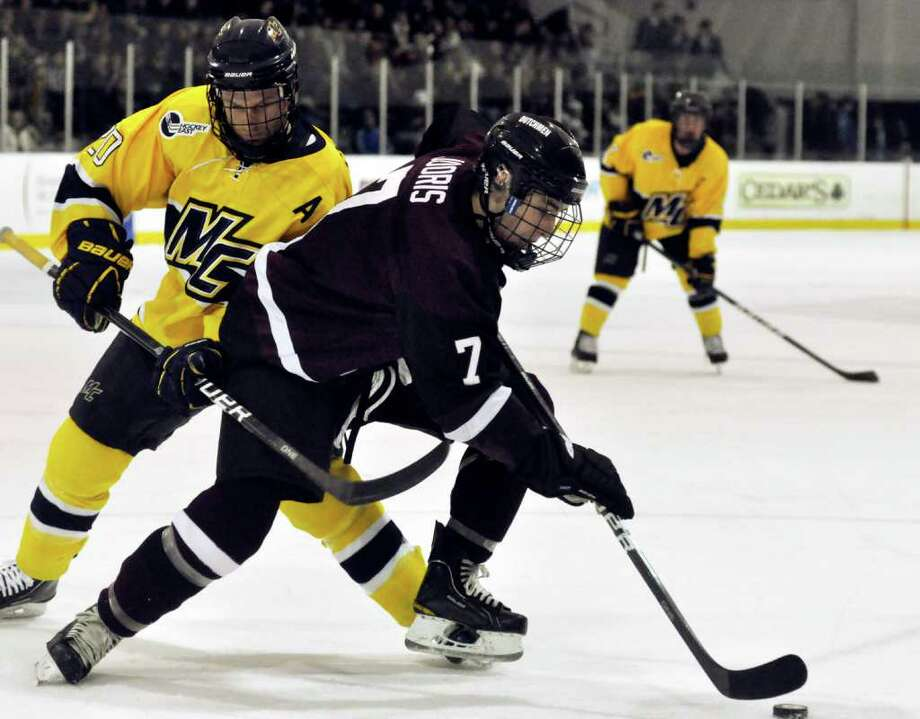 Josh Jooris (7) of Union wheels past Merrimack's Ryan Flanigan (20) during the second period of the No. 11 Skating Dutchmen's 3-1 win over the No. 5 Warriors, Saturday. DAN HICKLING/Special to the Times Union