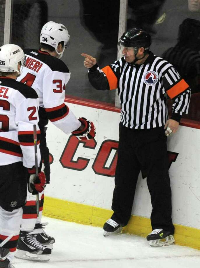 Nick Palmieri of the Albany Devils confronts a referee during a hockey game against Syracuse at the Times Union Center Wednesday, Dec. 14, 2011 in Albany, N.Y.  (Lori Van Buren / Times Union) Photo: Lori Van Buren
