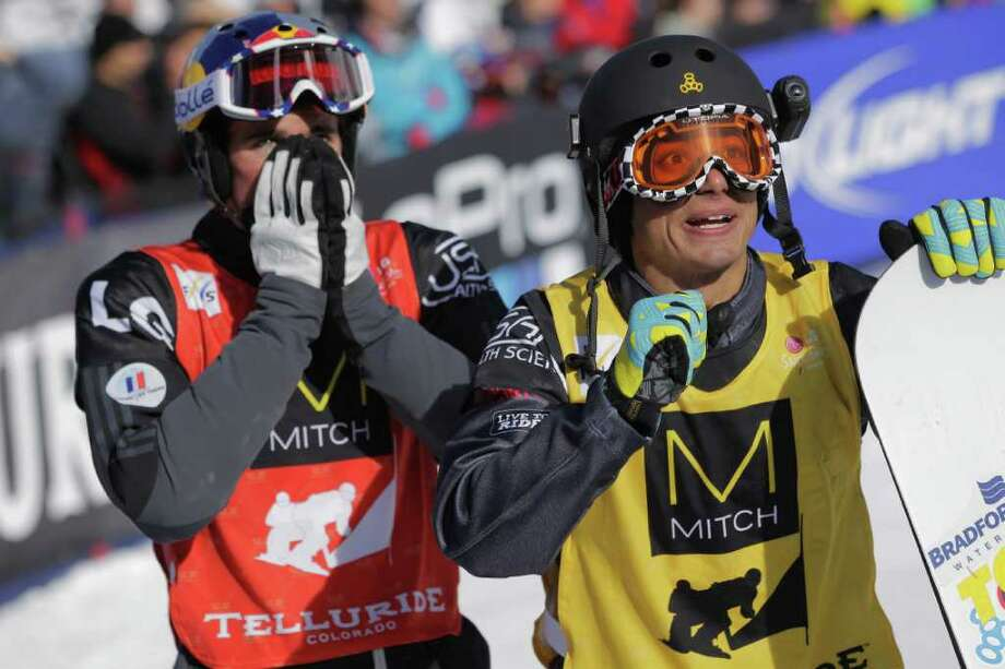 TELLURIDE, CO - DECEMBER 17:  (L-R) Pierre Vaultier of France and Jonathan Cheever react as they watch the video screen as their teammates Xavier de la Rue of France and Nick Baumgartner battle in the finals of the men's team snowboardcross at the LG Snowboard FIS World Cup on December 17, 2011 in Telluride, Colorado. Vaultier and de la Rue took first place while Cheever and Baumgartner finished second.  (Photo by Doug Pensinger/Getty Images) Photo: Doug Pensinger