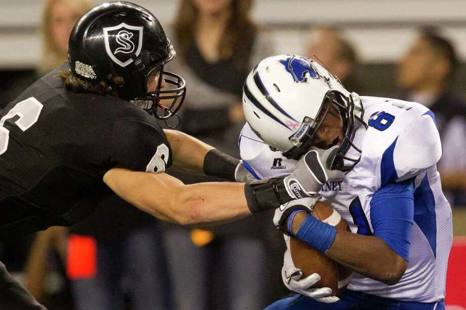 Dekaney wide receiver Austin Garrett (81) scores on a touchdown pass despite having his face mask grabbed by Cibolo Steele defensive back Erik Huhn (6) defends during the first half of the 5A Div. 2 state championship high school football game at Cowboys Stadium on Saturday, Dec. 17, 2011, in Arlington. Photo: Smiley N. Pool, Houston Chronicle / © 2011  Houston Chronicle