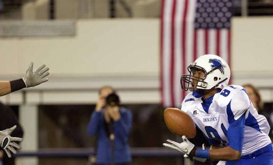 Dekaney wide receiver Austin Garrett (81) hauls in a touchdown pass against Cibolo Steele during the first half of the 5A Div. 2 state championship high school football game at Cowboys Stadium on Saturday, Dec. 17, 2011, in Arlington. Photo: Smiley N. Pool, Houston Chronicle / © 2011  Houston Chronicle