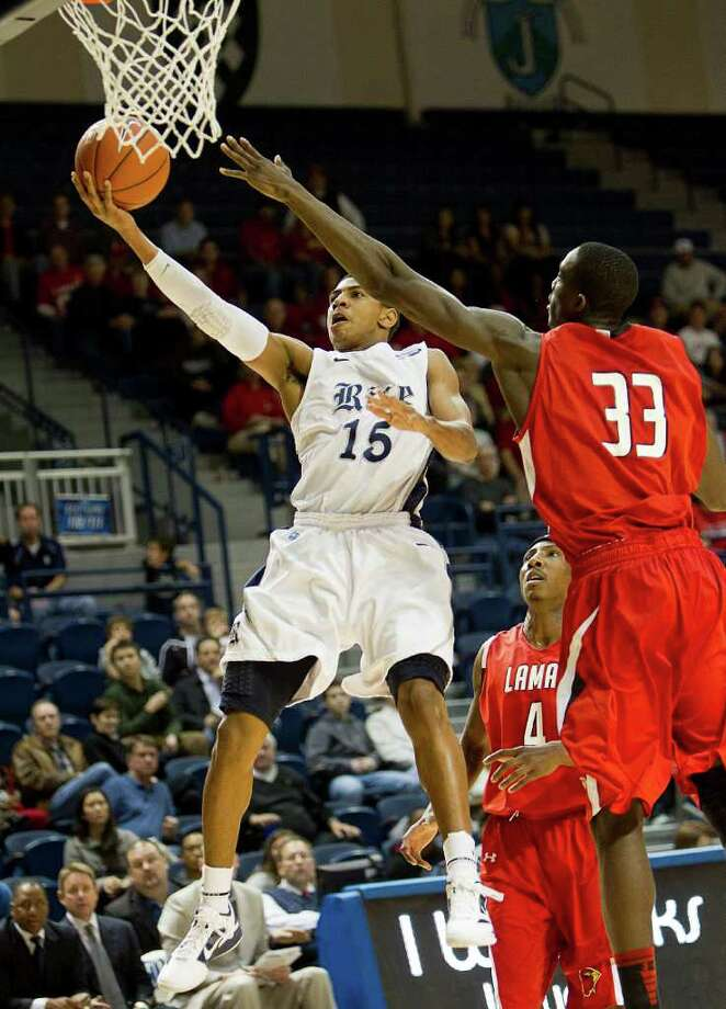 Dec. 17: Lamar 87, Rice 81. Rice's Julian DeBose (15) drives to the basket past Lamar's Osas Ebomwonyi (33) during the second half of an NCAA basketball game between the Lamar Cardinals and the Rice Owls Saturday, December 17, 2011 in Houston. Photo: Bob Levey, Houston Chronicle / ©2011 Bob Levey