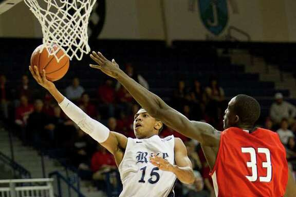 Rice's Julian DeBose (15) drives to the basket past Lamar's Osas Ebomwonyi (33) during the second half of an NCAA basketball game between the Lamar Cardinals and the Rice Owls Saturday, December 17, 2011 in Houston. Lamar defeated Rice 87-81.