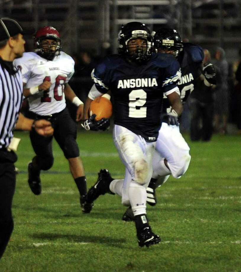 Ansonia's #2 Arkeel Newsome runs the ball in for a touchdown during boys football action against Torrington in Ansonia, Conn. on Thursday September 14, 2011. Photo: Christian Abraham / Connecticut Post