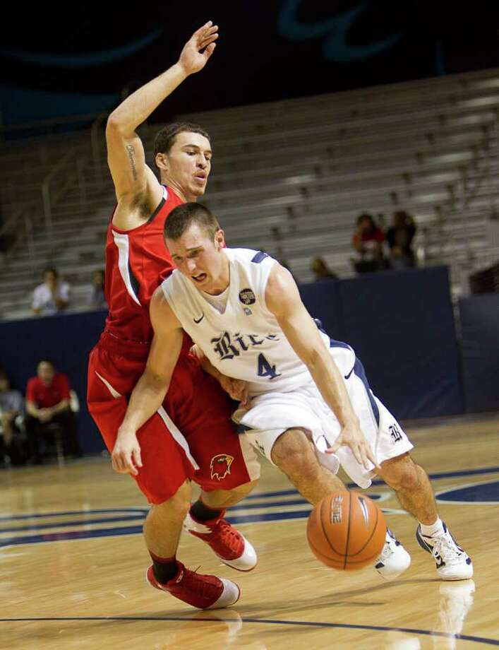 Rice's Connor Frizzelle (4) drives around Lamar's Mike James (5) during the second half of an NCAA basketball game between the Lamar Cardinals and the Rice Owls Saturday, December 17, 2011 in Houston. Lamar defeated Rice 87-81. Photo: Bob Levey, Houston Chronicle / ©2011 Bob Levey