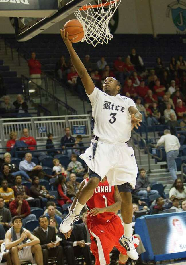 Rice's Tamir Jackson (3) drivers to the basket for a layup during the second half of an NCAA basketball game between the Lamar Cardinals and the Rice Owls Saturday, December 17, 2011 in Houston. Lamar defeated Rice 87-81. Photo: Bob Levey, Houston Chronicle / ©2011 Bob Levey