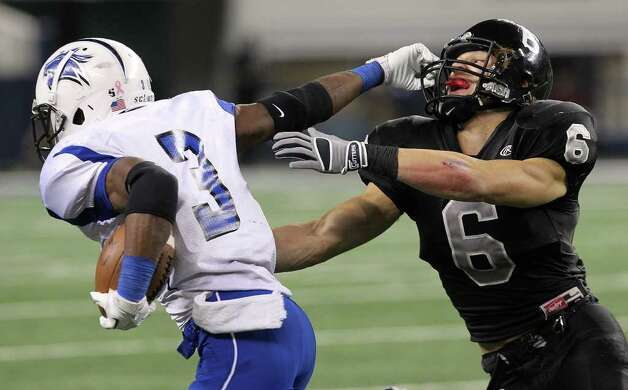 Steele's Erik Huhn (06) attempts to tackle Spring Dekaney's Trey Williams (3) in the first half of the Class 5A Div. II state championship football game at Cowboys Stadium in Arlington on Saturday, Dec. 17, 2011. Kin Man Hui/kmhui@express-news.net Photo: Kin Man Hui, Express-News / San Antonio Express-News