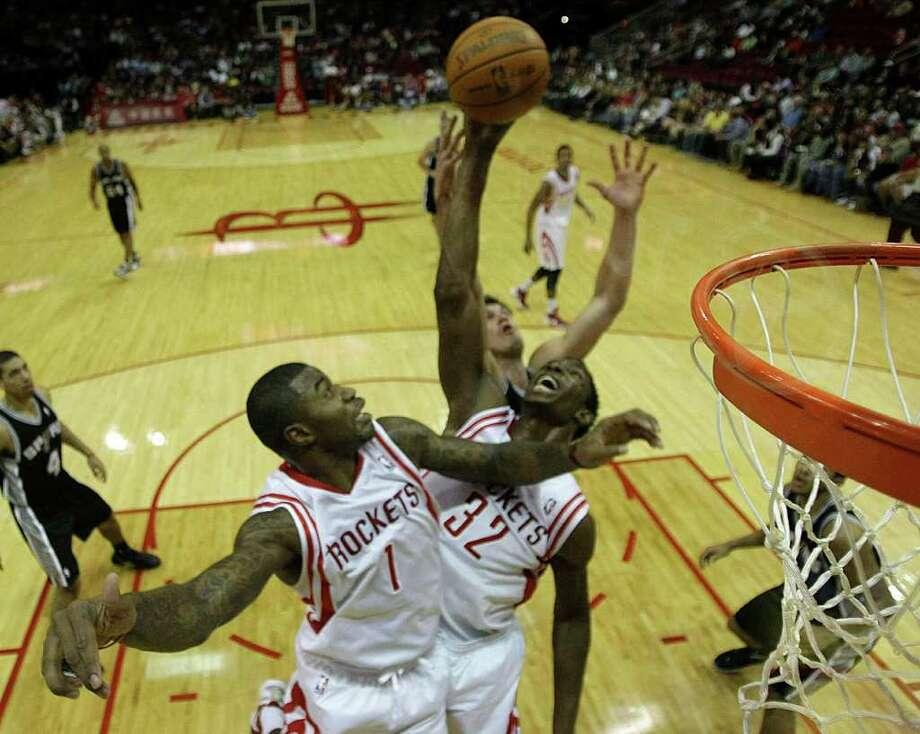 BRETT COOMER: CHRONICLE AERIAL FIGHT: Rockets forward Terrence Williams (1) and center Hasheem Thabeet (32) battle the Spurs' Tiago Splitter. Photo: Brett Coomer / © 2011 Houston Chronicle