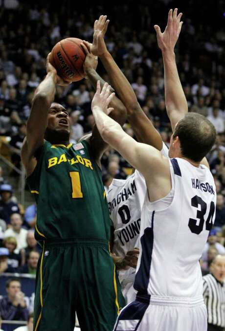 JIM URQUART : ASSOCIATED PRESS RISING UP : Baylor forward Perry Jones III (1) came up big for the undefeated No. 6 Bears in a close win over the BYU Cougars. Photo: Jim Urquhart / 2011 Jim Urquhart/AP