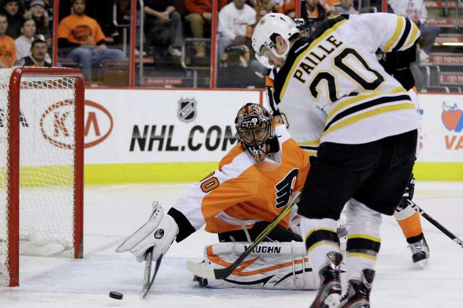 Boston Bruins' Daniel Paille (20) scores past Philadelphia Flyers' Ilya Bryzgalov (30), of Russia, in the first period of an NHL hockey game, Saturday, Dec. 17, 2011, in Philadelphia. (AP Photo/Matt Slocum) Photo: Matt Slocum