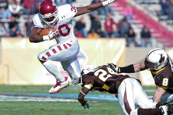 Temple running back Bernard Pierce (30) leaps over Wyoming defensive back Kenny Browder (24) and linebacker Brian Hendricks (8) in the second quarter of the New Mexico Bowl NCAA college football game in Albuquerque, N.M., Saturday, Dec. 17, 2011. (AP Photo/Jake Schoellkopf)