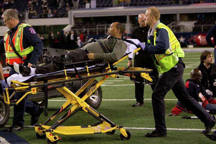 Medical personnel tend to person injured on the field after a cart ran into a crowd following the