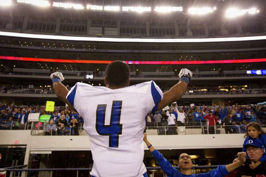 Dekaney's Myles Curd (4) celebrates following the Wildcats victory over Cibolo Steele in the 5A Div. 2 state championship high school football game at Cowboys Stadium on Saturday, Dec. 17, 2011, in Arlington.   Dekaney won the game 34-14. Photo: Smiley N. Pool, Houston Chronicle / © 2011  Houston Chronicle