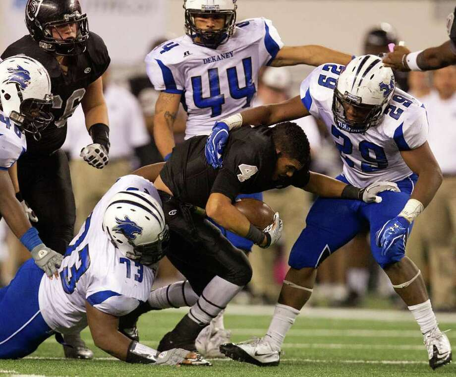 Who lost his head: Cibolo Steele running back Justin Stockon. Who did the headhunting: Dekaney. Photo: Smiley N. Pool, Houston Chronicle / © 2011  Houston Chronicle
