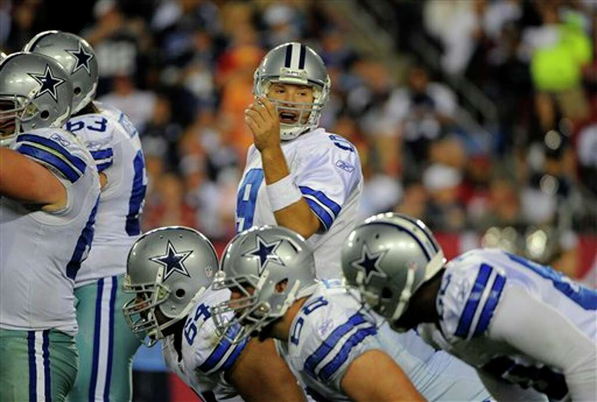 Dallas Cowboys quarterback Tony Romo (9) directs the offense during an NFL football game against the Tampa Bay Buccaneers Saturday, Dec. 17, 2011, in Tampa, Fla. (AP Photo/Brian Blanco)