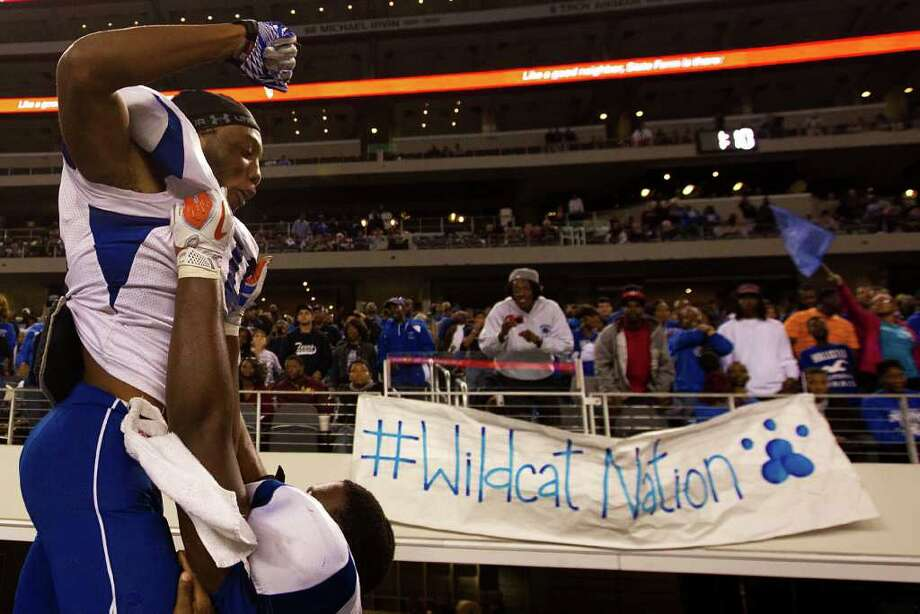 Dekaney's Jarrett Irving (14) celebrates following the Wildcats victory over Cibolo Steele in the 5A Div. 2 state championship high school football game at Cowboys Stadium on Saturday, Dec. 17, 2011, in Arlington.   Dekaney won the game 34-14. Photo: Smiley N. Pool, Houston Chronicle / © 2011  Houston Chronicle