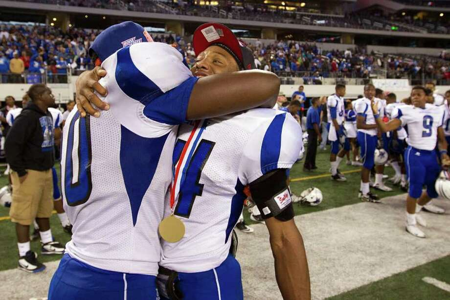 SMILEY N. POOL : HOUSTON CHRONICLE CELEBRATION TIME : Dekaney's Jarrett Irving, right, had plenty to smile about after the Wildcats topped Cibolo Steele for the Class 5A Division II state title. Photo: Smiley N. Pool / © 2011  Houston Chronicle