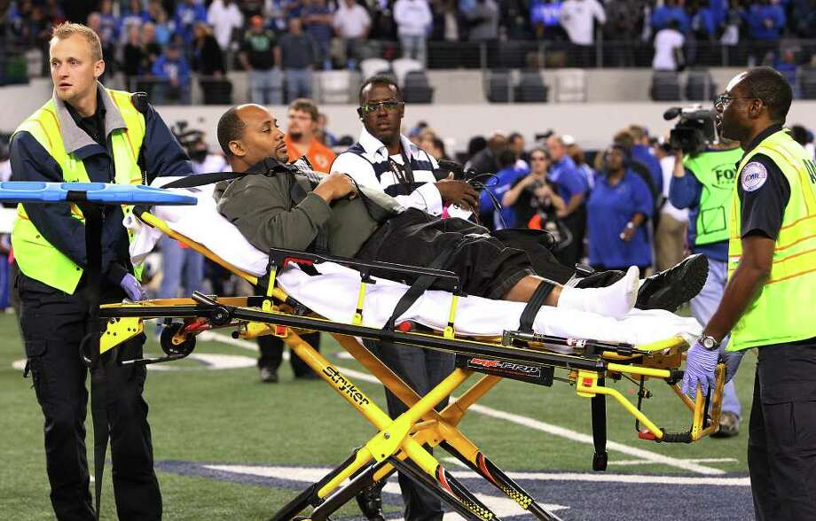 An unidentified individual gets medical attention after being hit by a runaway cart after the Steele-Spring Dekaney Class 5A Div. II state championship football game at Cowboys Stadium in Arlington on Saturday, Dec. 17, 2011. Kin Man Hui/kmhui@express-news.net Photo: Kin Man Hui, Express-News / San Antonio Express-News