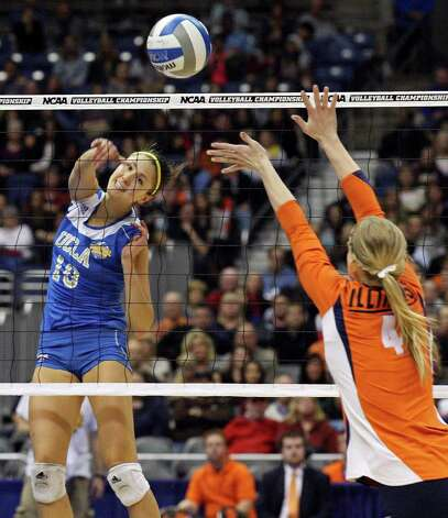 UCLA's Bojana Todorovic hits a kill over Illinois' Colleen Ward  during the 2011 NCAA Division I Women's Volleyball National Championship match Saturday Dec. 17, 2011 at the Alamodome.  PHOTO BY EDWARD A. ORNELAS/eaornelas@express-news.net) Photo: EDWARD A. ORNELAS, Express-News / © SAN ANTONIO EXPRESS-NEWS (NFS)