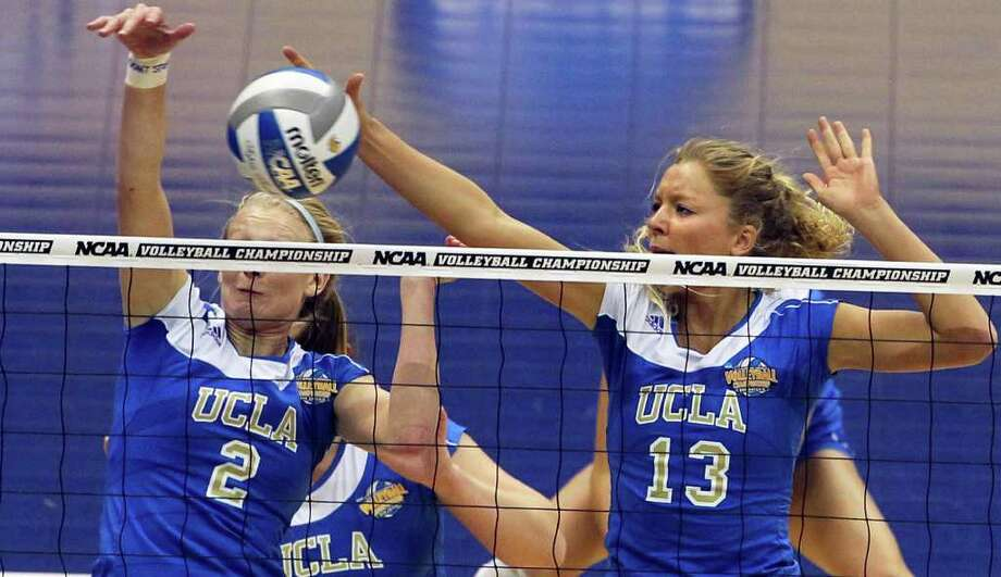 Zoe Nightingale hawks another shot on the net for a block for the Bruins as UCLA plays Illinois in the  2011 NCAA National Championship volleyball match at the Alamodome on December 17, 2011 Tom Reel/Staff Photo: TOM REEL, Express-News / © 2011 San Antonio Express-News