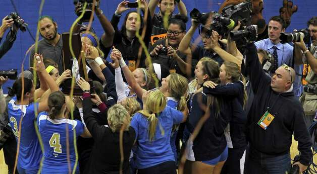 Bruins raise the trophy as UCLA beats  Illinois in the  2011 NCAA National Championship volleyball match at the Alamodome on December 17, 2011 Tom Reel/Staff Photo: TOM REEL, Express-News / © 2011 San Antonio Express-News
