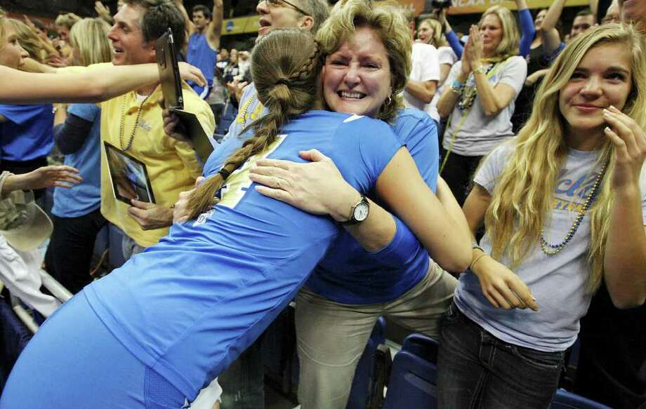 UCLA's Sara Sage hugs her mom Beth Sage after the 2011 NCAA Division I Women's Volleyball National Championship match with Illinois Saturday Dec. 17, 2011 at the Alamodome. UCLA won 3-1. PHOTO BY EDWARD A. ORNELAS/eaornelas@express-news.net) Photo: EDWARD A. ORNELAS, Express-News / © SAN ANTONIO EXPRESS-NEWS (NFS)