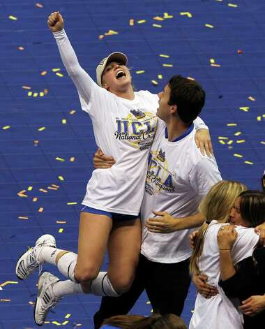 Lainey Gera pumps her fist as UCLA beats  Illinois in the  2011 NCAA National Championship volleyball match at the Alamodome on December 17, 2011 Tom Reel/Staff Photo: TOM REEL, Express-News / © 2011 San Antonio Express-News