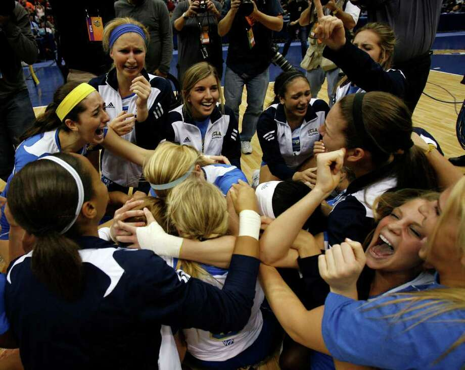 UCLA players celebrate after defeating Illinois in the 2011 NCAA Division I Women's Volleyball National Championship Match at the Alamodome on Saturday, Dec. 17, 2011. UCLA won in four sets, 25-23, 23-25, 26-24, 25-16. MICHAEL MILLER / mmiller@express-news.net Photo: MICHAEL MILLER, Express-News / mmiller@express-news.net